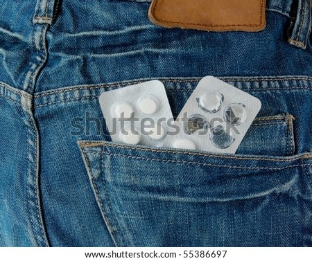 pills in jeans pocket - stock photo