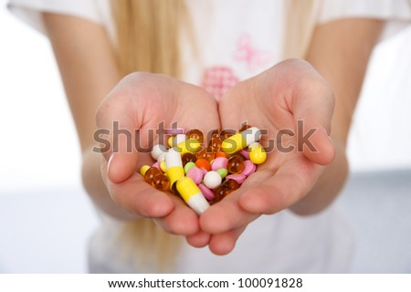 pills in kid hands. isolated on white background - stock photo