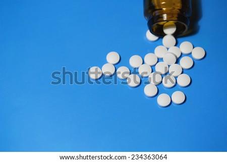 pills in pill bottle  - stock photo