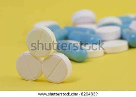 Pills in structure over yellow