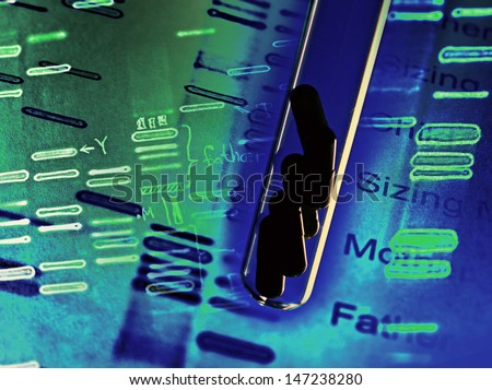Pills in test tube and DNA fingerprints