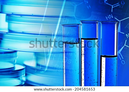 Pills in test tube over blue background.