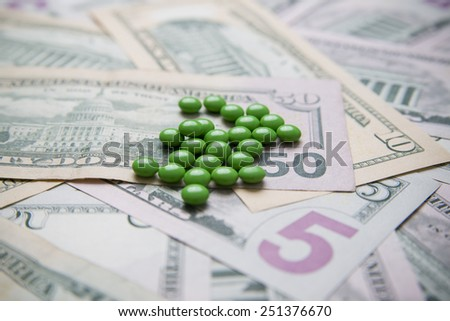 Pills on a background of money. Medicine. Concept. - stock photo
