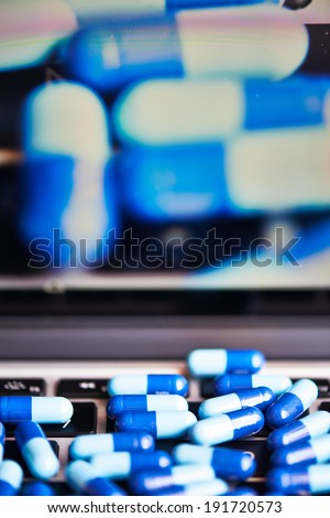 pills on a keyboard. drugs and medicine, pills and capsules.