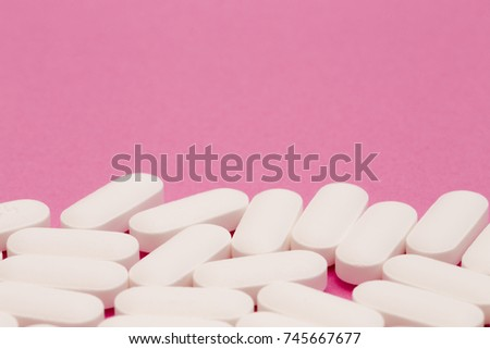 Pills on a Pink Background