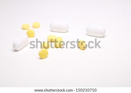 Pills on a white background. - stock photo