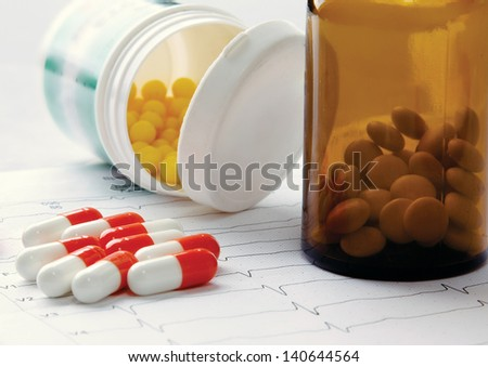 pills on the cardiogram - stock photo