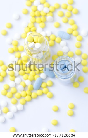 Pills out of pill bottle - stock photo