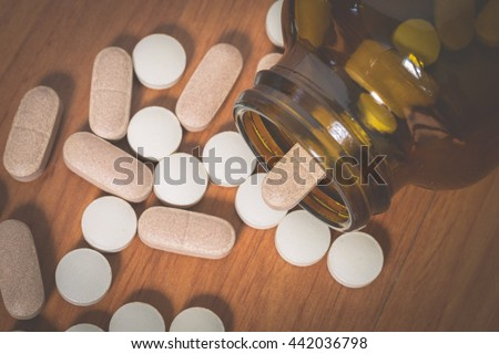 Pills out of pill bottle