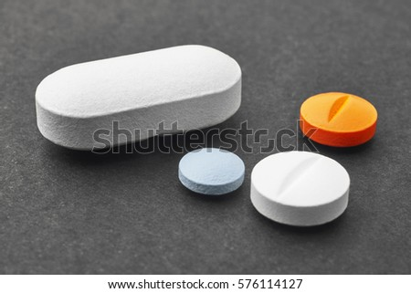 Pills over a black background. Medicament treatment. Health care photo