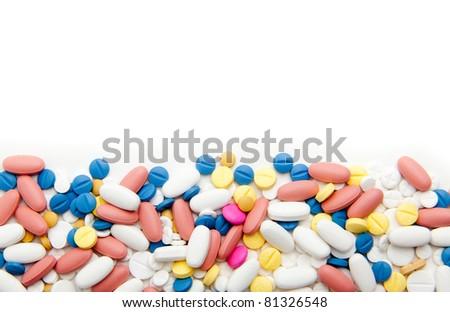 pills over white - stock photo