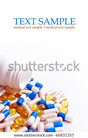 Pills pouring out. Prescription open bottle isolated on white background