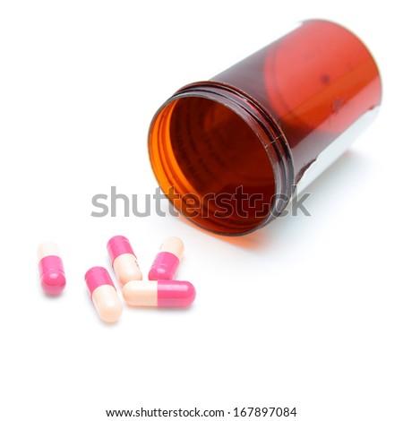 Pills spilling from Bottle - stock photo