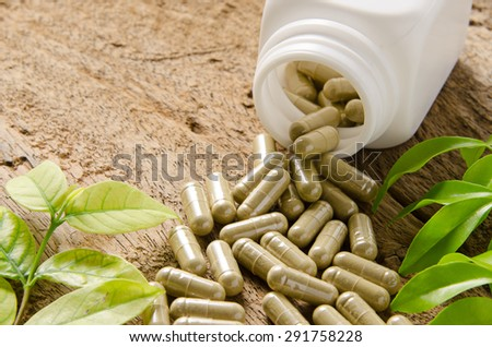 Pills spilling from Bottle - stock photo