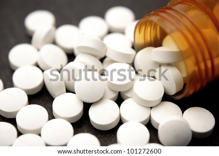 Pills spilling from container