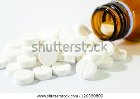 Pills Spilling out of Pill Bottle Shallow DOF - stock photo