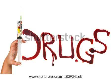 Pills, syringe and bloody letters as a symbol of drug addiction - stock photo