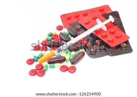 pills, syringe and empty blister pack - stock photo