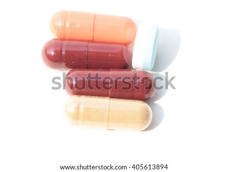 Pills. Tablets. Capsule. Heap of pills. Medical background. Close-up of pile of yellow green tablets - capsule. Pills and tablets. white background. - stock photo