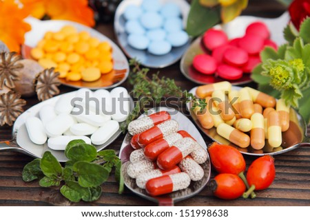Pills, tablets, capsules and medicinal herbs - stock photo