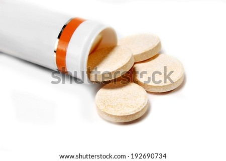 Pills tablets medicines drugs medication treatment in a bottle for a medical health condition - isolated on white background - stock photo