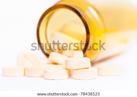 Pills with bottle on isolated white background