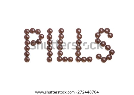 Pills written with brown pills - white background - stock photo