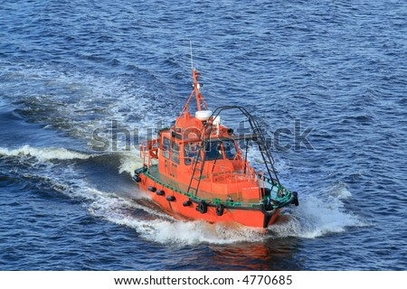 pilot boat on a move in the sea - stock photo