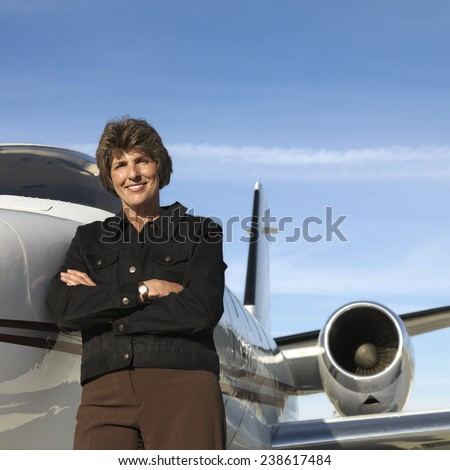 Pilot in Front of Private Jet - stock photo