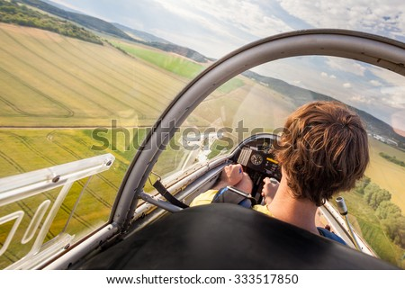 pilot in the cockpit of a glider at landing - stock photo