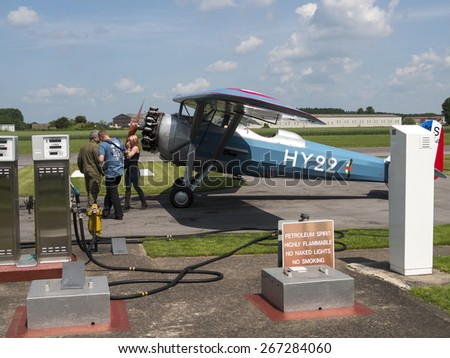 pilot refuels his aircraft at Breighton airfield,yorkshire,UK.taken 14/07/2013 - stock photo
