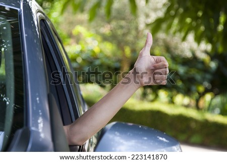 pilot's hand with ok sign, vintage effect - stock photo