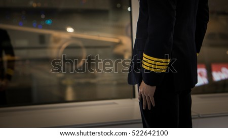 pilot wear four golden strips jacket in airport terminal