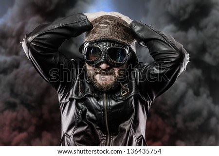 pilot with glasses and vintage hat over background explosion - stock photo
