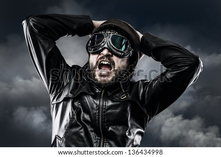 pilot with glasses and vintage hat with expression of surprise - stock photo