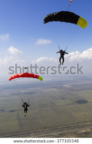 Piloting the parachute in the clouds. - stock photo