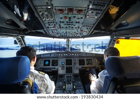 Pilots in the plane cockpit - stock photo