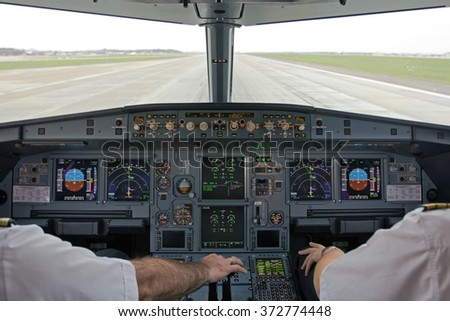 Pilots prepared aircraft for take-off - stock photo