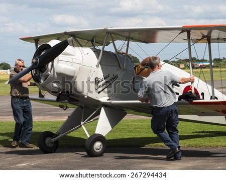 pilots with their 1930s Bucker biplane aircraft at Breighton airfield,yorkshire,UK.taken 14/07/2013 - stock photo