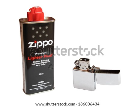 PILSEN, CZECH REPUBLIC - APRIL 6, 2014: Zippo lighter with original fluid can, isolated on white background. Zippo lighters became popular in the United States military during Second World War. - stock photo