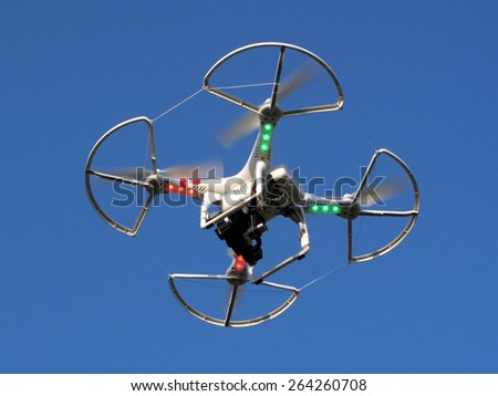 PILSEN, CZECH REPUBLIC - MARCH 19, 2015: Drone quadcopter Dji Phantom 2 with digital camera GoPro HERO4 in flight. - stock photo