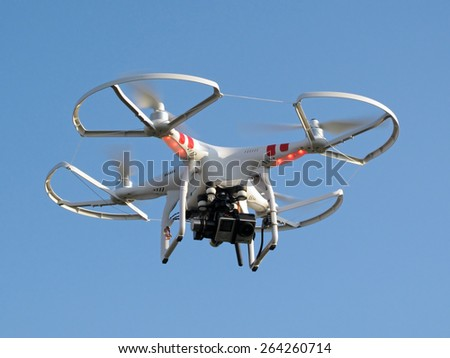 PILSEN, CZECH REPUBLIC - MARCH 19, 2015: Drone quadcopter Dji Phantom 2 with digital camera GoPro HERO4 in flight. - stock photo