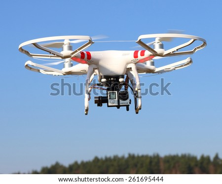 PILSEN CZECH REPUBLIC - MARCH 18, 2015: Drone quadrocopter Dji Phantom 2 with digital camera GoPro HERO4 Black edition. New tool for aerial photo and video. - stock photo