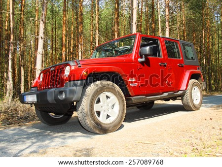 PILSEN CZECH REPUBLIC - MARCH 19, 2015: The Jeep Wrangler (Wrangler Unlimited model Sahara) is a four-wheel drive off-road and sport utility vehicle (SUV), manufactured by American automaker Chrysler. - stock photo