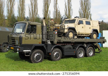 PILSEN, CZECH REPUBLIC - MAY 2, 2015: Iveco Light Multirole Vehicle on Tatra 815 truck, Czech Army. Liberation festival in Pilsen. - stock photo