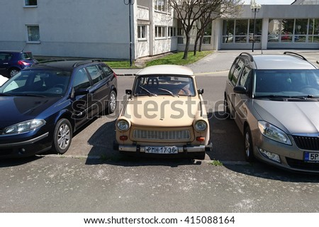 PILSEN, CZECH REPUBLIC - MAY 3, 2016: Trabant 1.1, a vintage car parking between modern cars. Famous car Trabant was produced in communist East Germany in years 1963-1991.