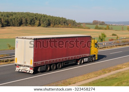 PILSEN, CZECH REPUBLIC - OCTOBER 2, 2015: Truck moving on the D5 highway. The D5 is important transport connection between West Bohemia and Bavaria in Germany. - stock photo