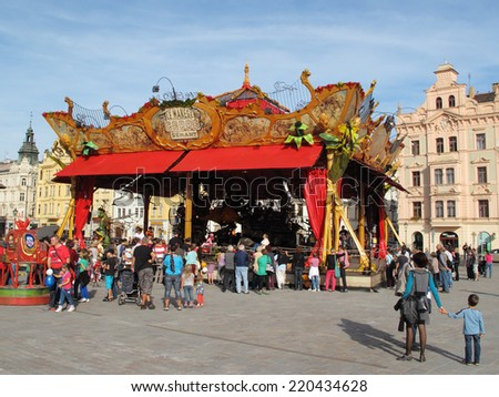 PILSEN, CZECH REPUBLIC - SEPTEMBER 28, 2014: Magical carrousel Le Manege Carre Senart on Namesti republiky square. Pilsen city celebrate title of the European Capital of Culture 2015. - stock photo