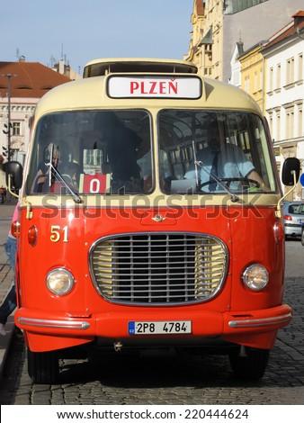 PILSEN, CZECH REPUBLIC - SEPTEMBER 28, 2014: Old historical bus on Pilsen square. Pilsen city celebrate title of the European Capital of Culture 2015. - stock photo