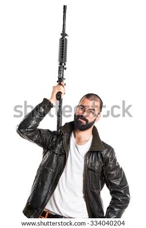 Pimp man holding a rifle - stock photo